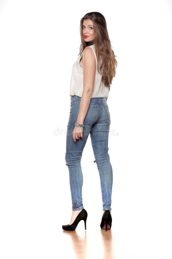 隔离牛仔裤白人妇女 图库摄影