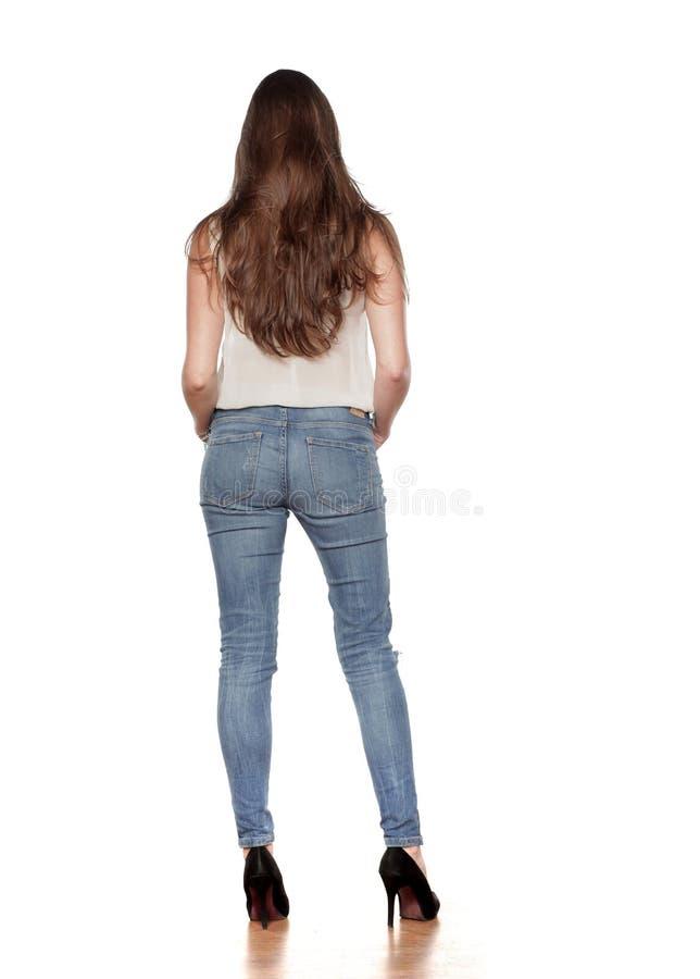 隔离牛仔裤白人妇女 库存图片