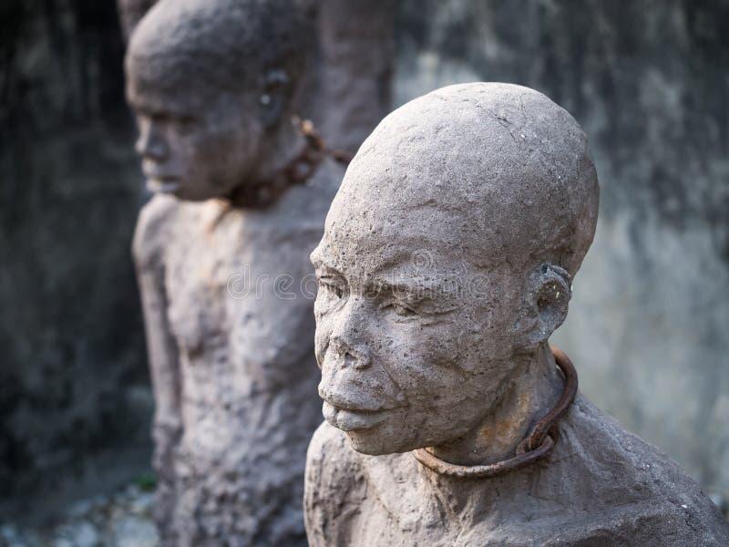 奴隶雕塑在桑给巴尔石头城,桑给巴尔 免版税图库摄影