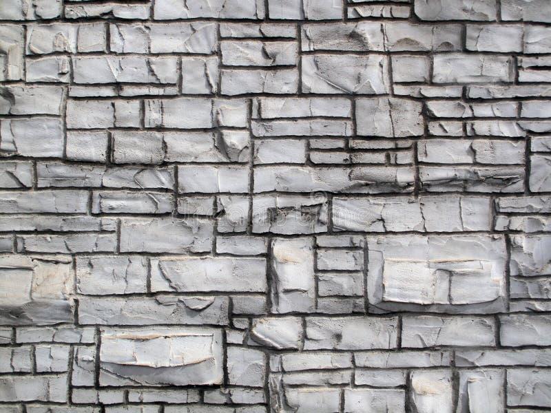 难看的东西制作了老岩石墙壁 库存图片