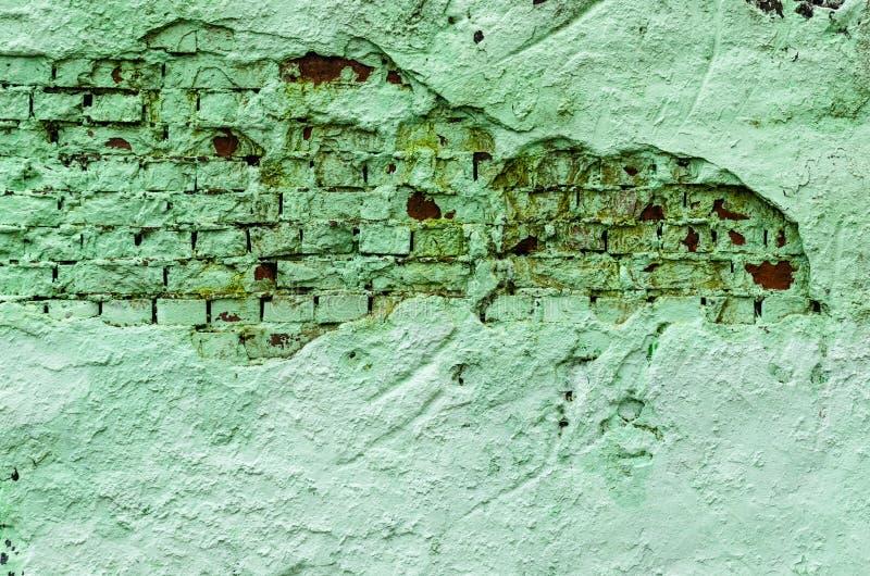 难看的东西在绿色口气的砖墙纹理 抽象背景纹理 库存照片