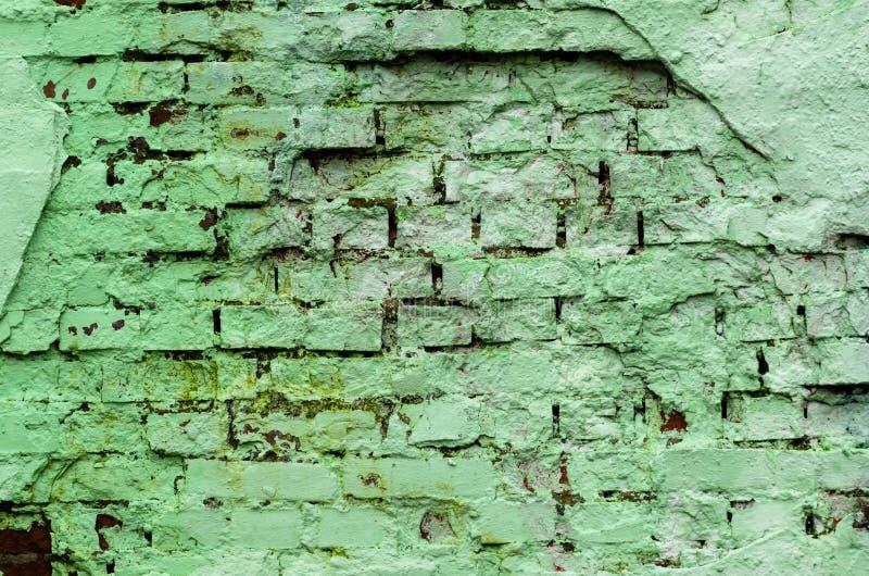 难看的东西在绿色口气的砖墙纹理 抽象背景纹理 免版税库存照片
