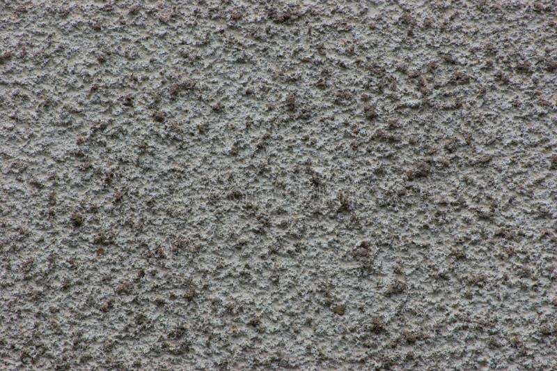 难看的东西灰色墙壁灰泥纹理,大详细的水平的织地不很细样式背景宏观特写镜头拷贝空间 免版税库存图片