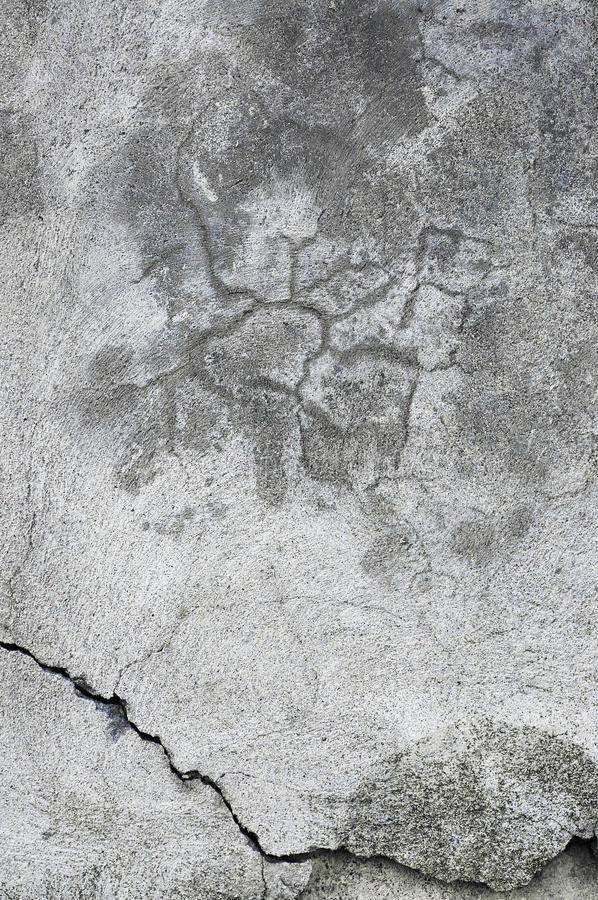 难看的东西灰色墙壁灰泥纹理,黑暗的自然灰色土气具体膏药宏观特写镜头,老年迈的详细粗砺破裂织地不很细 免版税库存图片