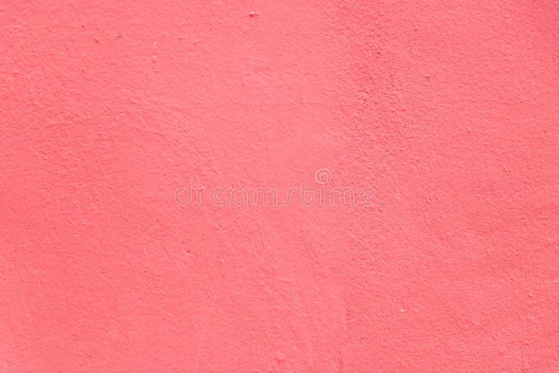 难看的东西红色混凝土墙纹理背景 库存照片