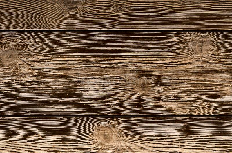 难看的东西背景老褐色烘烤了木头被风化的委员会被构造的表面,自然背景 库存照片