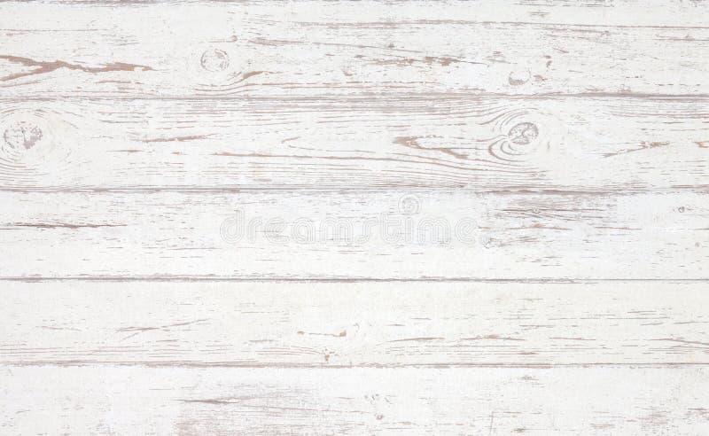 难看的东西背景 白色木纹理 在一个老木地板上的削皮油漆 免版税库存照片