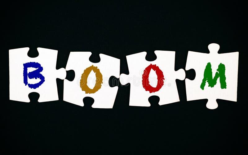 难题四个片断与信件的在黑背景兴旺 免版税库存图片