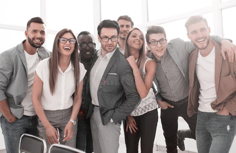 雄心勃勃的企业队身分在一个现代办公室 库存照片