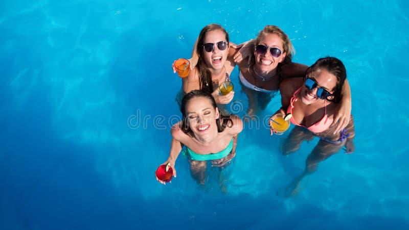 集会在水池的小组朋友 库存照片