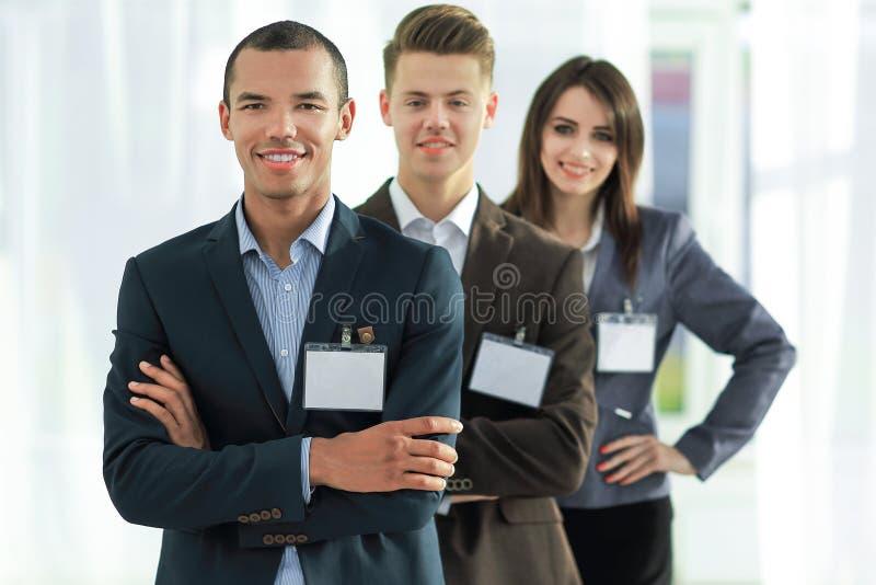 雇员小组有空白的徽章的,支持 免版税库存图片