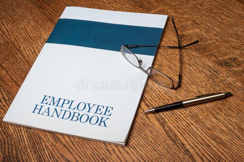 雇员手册 库存图片