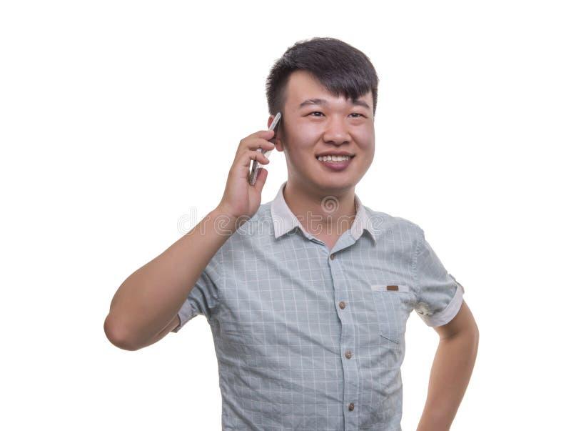 雍人谈话在他的智能手机 库存照片