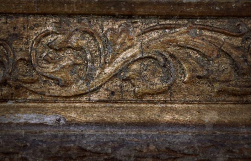 雕刻框架的老葡萄酒抓了木细节难看的东西样式表面抽象纹理背景 库存照片