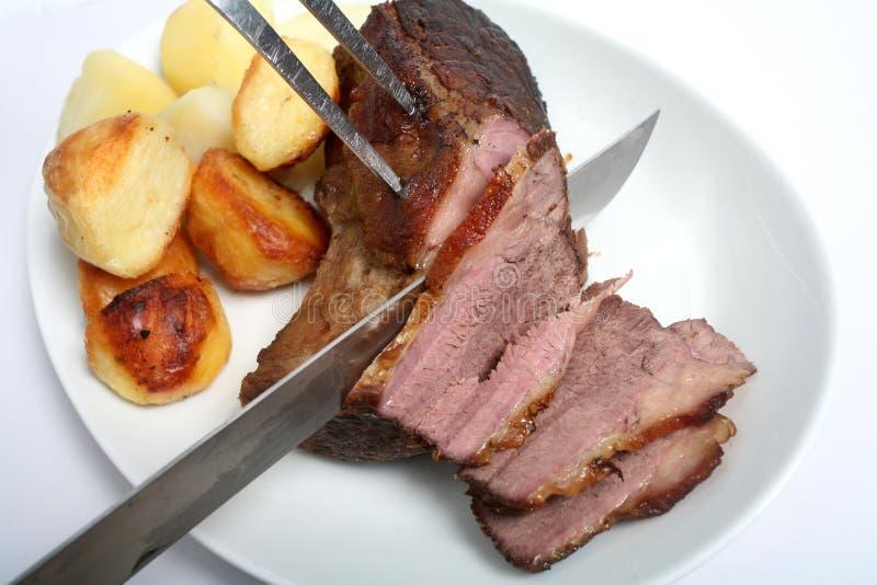雕刻烘烤的牛肉 库存图片