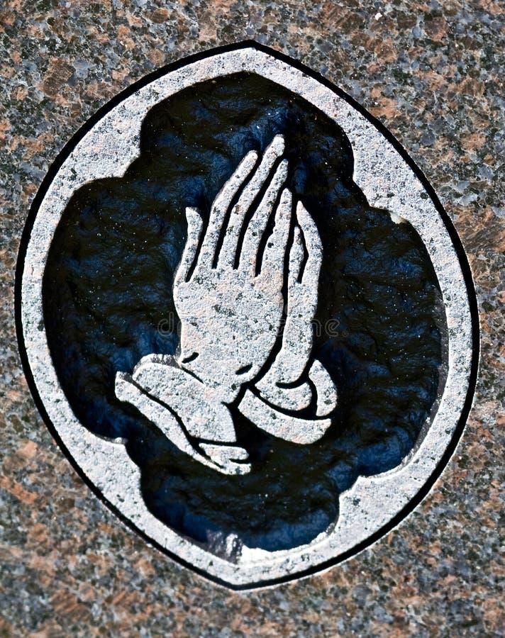 雕刻祈祷石头的现有量 库存图片