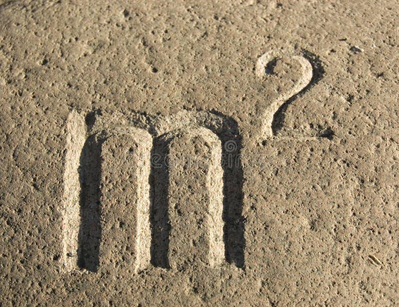 雕刻米符号正方形石头 库存照片