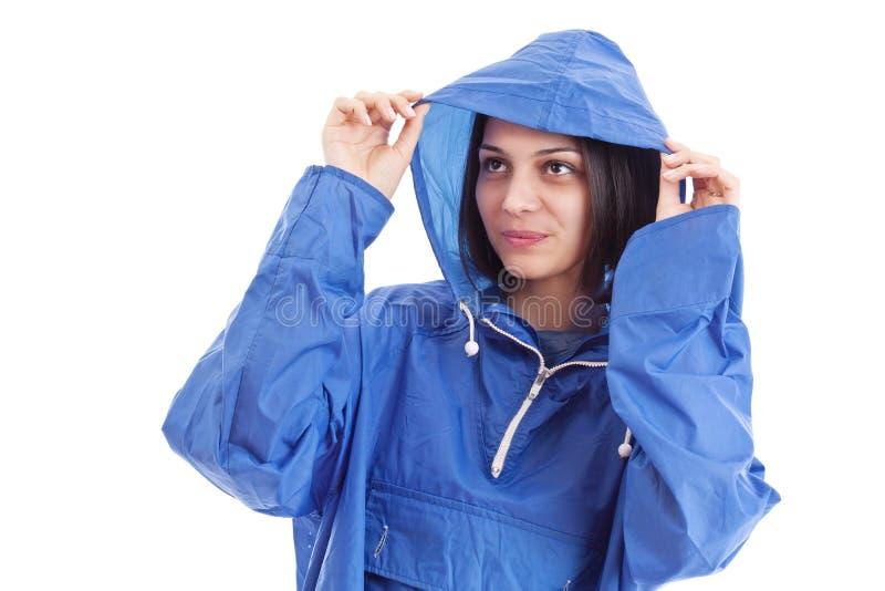 雨衣佩带的妇女 免版税库存图片