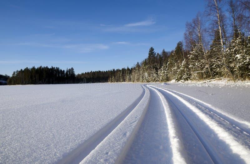 雪上电车足迹 图库摄影