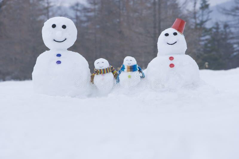 雪人家庭 库存图片