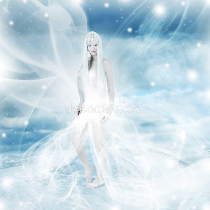 雪冬天背景的神仙的妇女 免版税库存照片