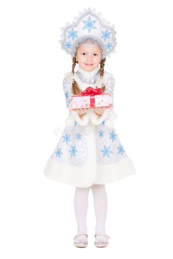 雪少女服装的女孩 免版税库存图片