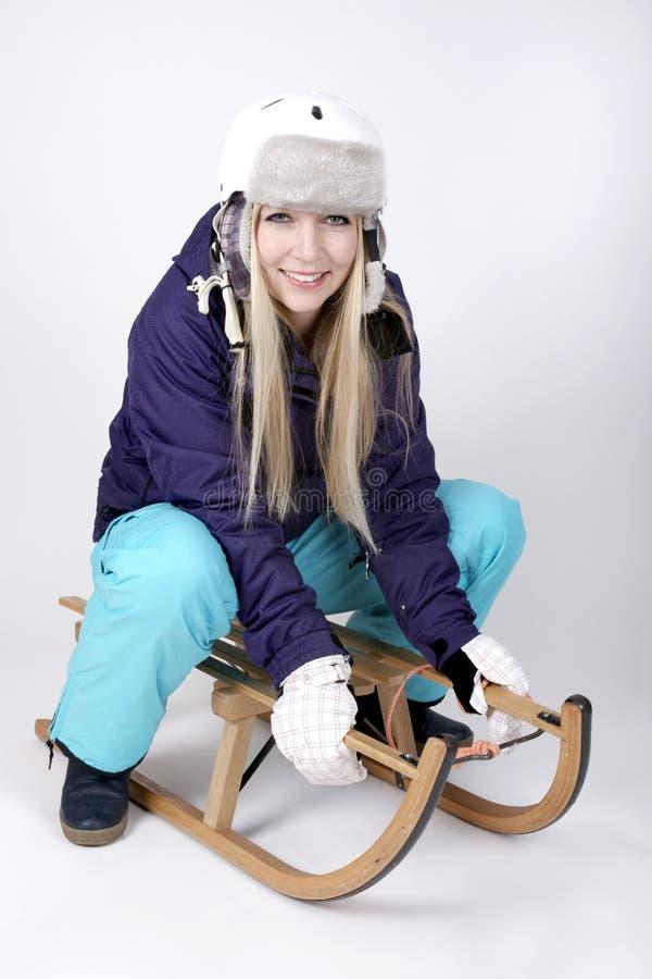雪橇的妇女 库存图片