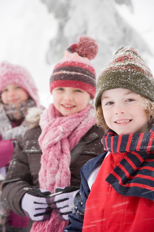 Download 雪的孩子 库存图片. 图片 包括有 女孩, 乐趣, 帽子, 种族, 干净, 同学, 差别, 欢乐, 好奇 - 62534737