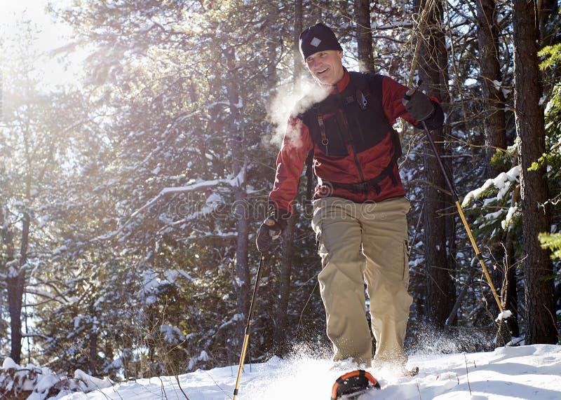 雪靴的有效的前辈在冬天 免版税库存图片