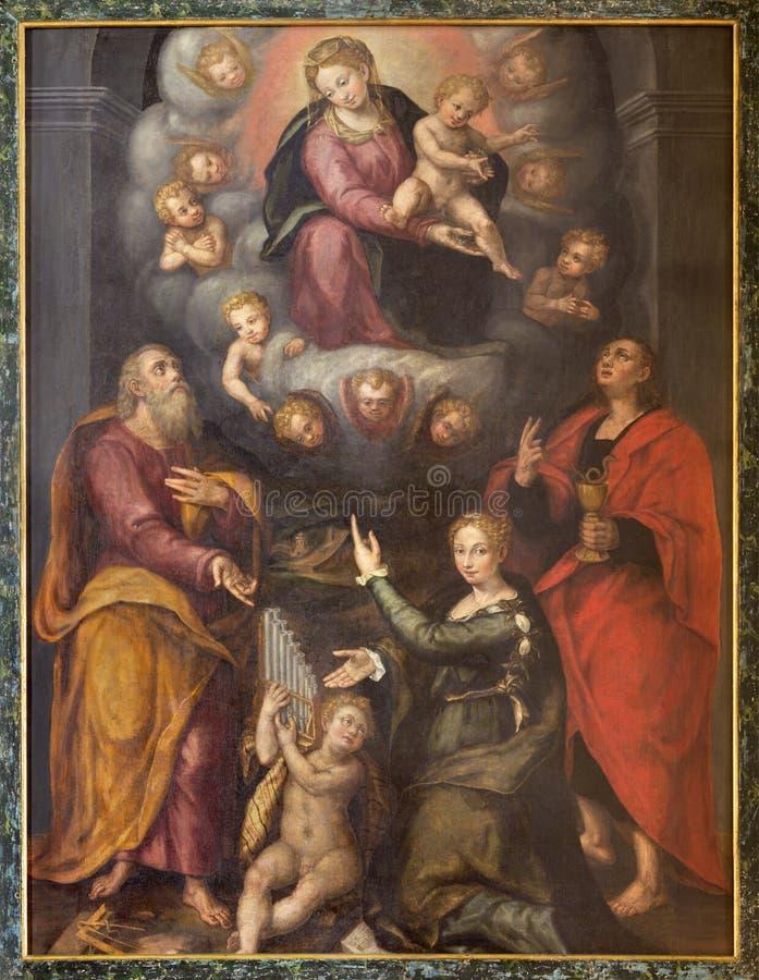 雷焦艾米利亚,意大利- 2018年4月13日:玛丹娜绘画和圣约瑟夫、福音书作者约翰和塞西莉亚 图库摄影