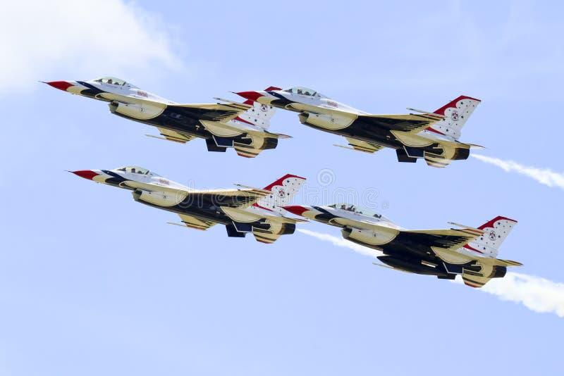 雷鸟有燃烧器的战斗喷气机 免版税库存照片