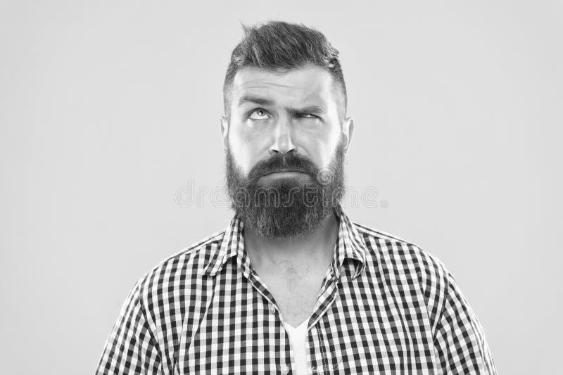需要认为 抬眼眉的人严肃的面孔不确信 有一些疑义 不肯定行家有胡子的面孔  免版税库存照片
