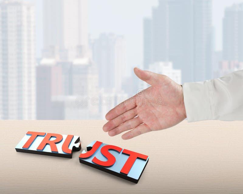 震动与词信任的手和难题片断 免版税库存图片