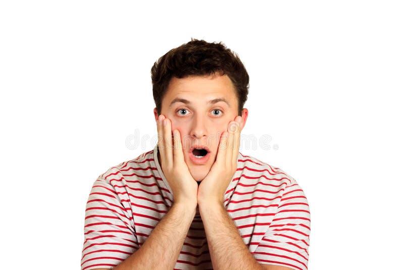 震惊人开头嘴宽被张开的和感人的面孔用手 在白色背景隔绝的情感人 库存图片