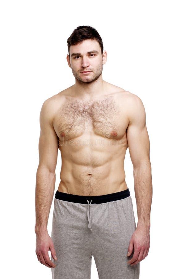 在白色背景站立的露胸部的人 免版税库存图片