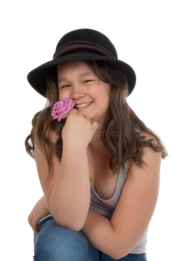 青少年亚洲黑色女孩的帽子 免版税库存图片
