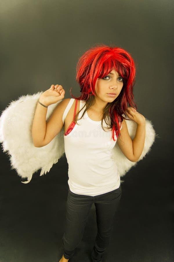 青少年天使的红头发人 免版税库存照片