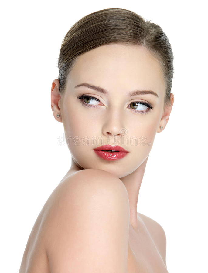 青少年女孩唇膏红色的淫荡 免版税库存照片