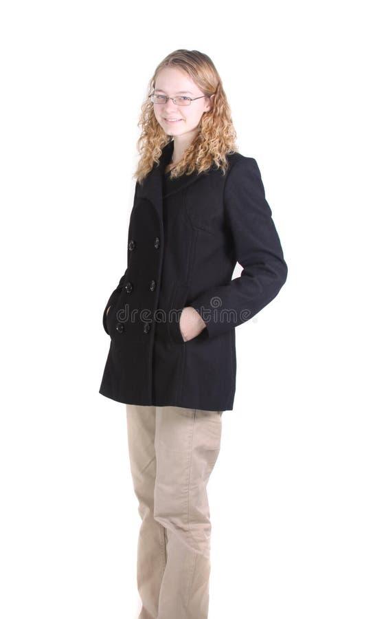青少年女孩的大衣 免版税库存照片