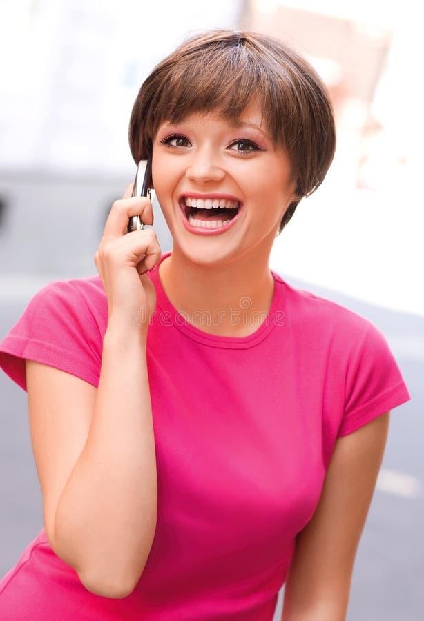 青少年女孩的移动电话 库存图片