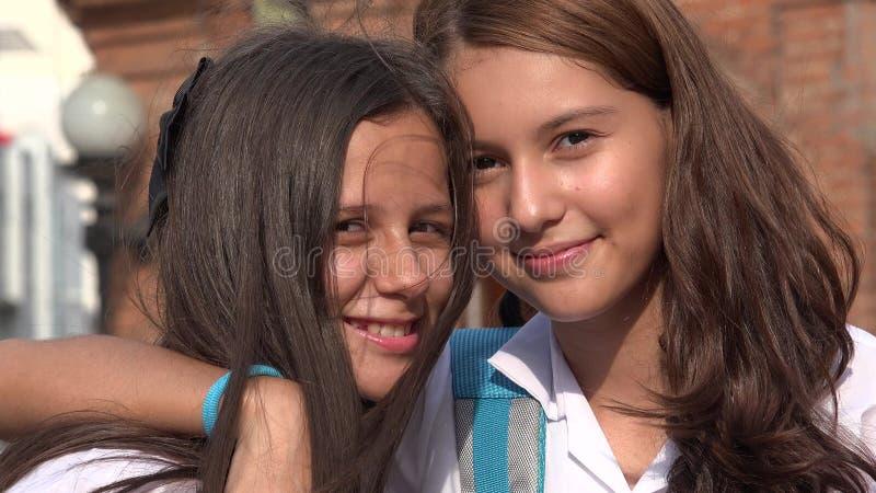 青少年女朋友微笑 图库摄影