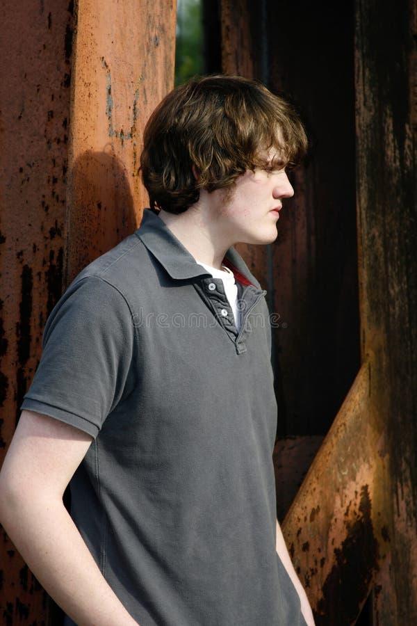 青少年户外的男孩 免版税图库摄影