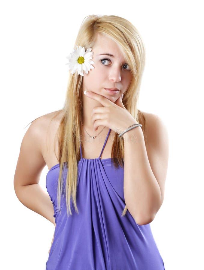青少年白肤金发的雏菊的女孩 库存图片