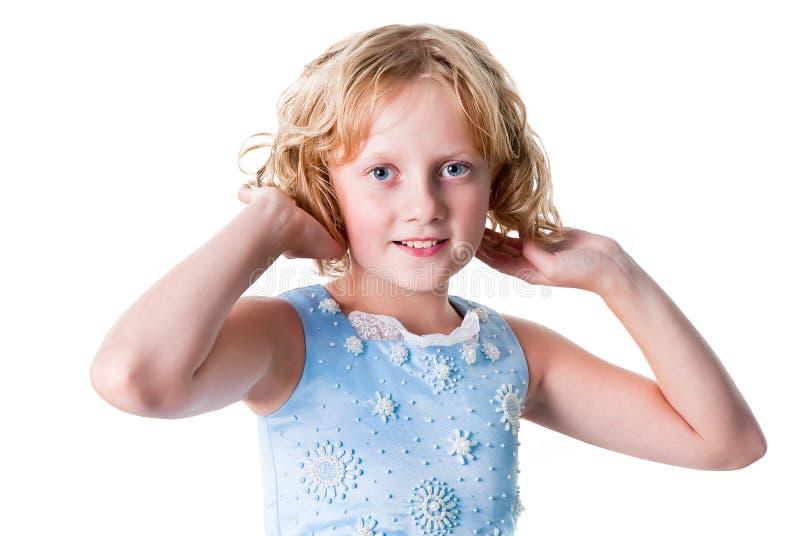青少年的女孩为在白色查出的当事人装饰 免版税库存图片