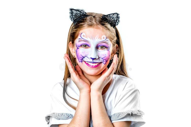 青少年的女孩画象有猫面孔绘画的 免版税库存图片