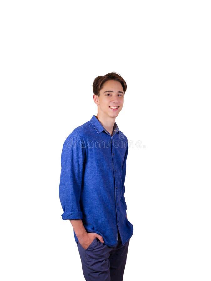 青少年的男孩画象蓝色牛仔裤衬衣的 免版税库存照片