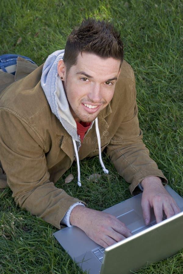 青少年的膝上型计算机 图库摄影
