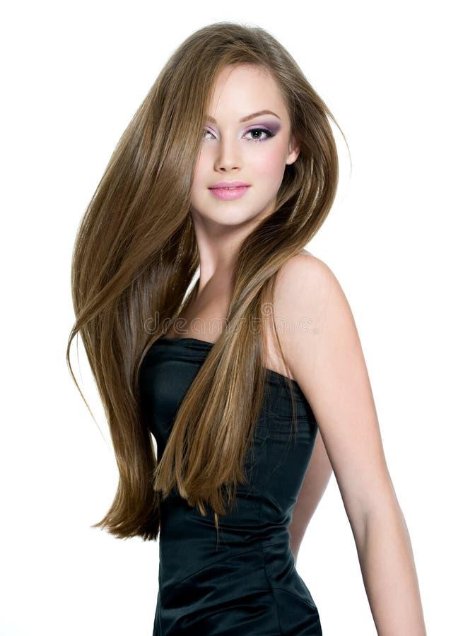 青少年直接长期美丽的女孩的头发 库存图片