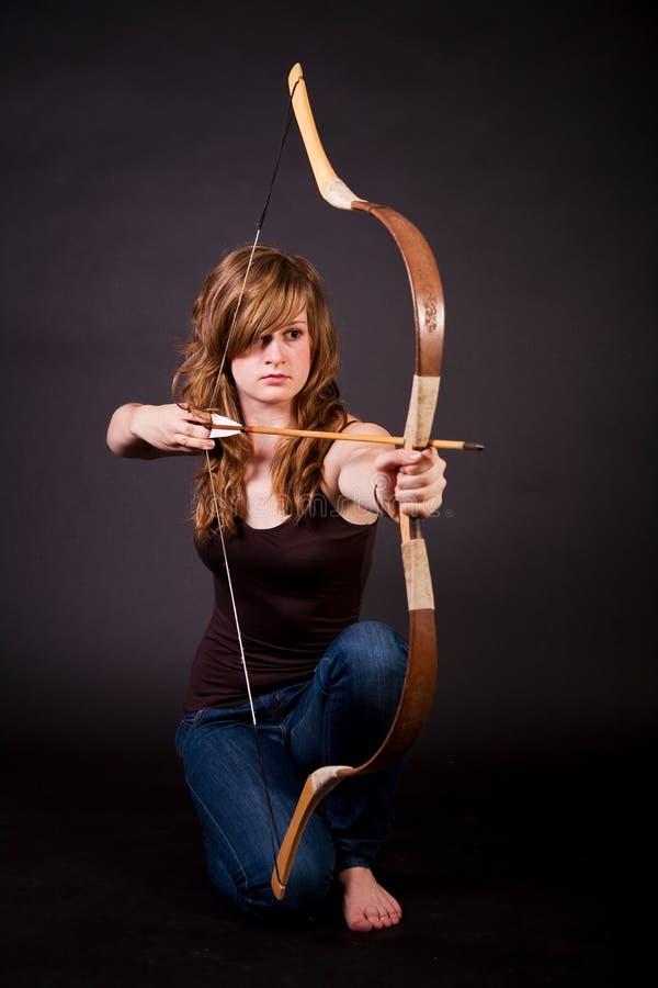 青少年美丽的弓的女孩 免版税库存图片