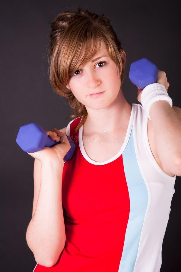 青少年美好的礼服女孩的体育运动 图库摄影